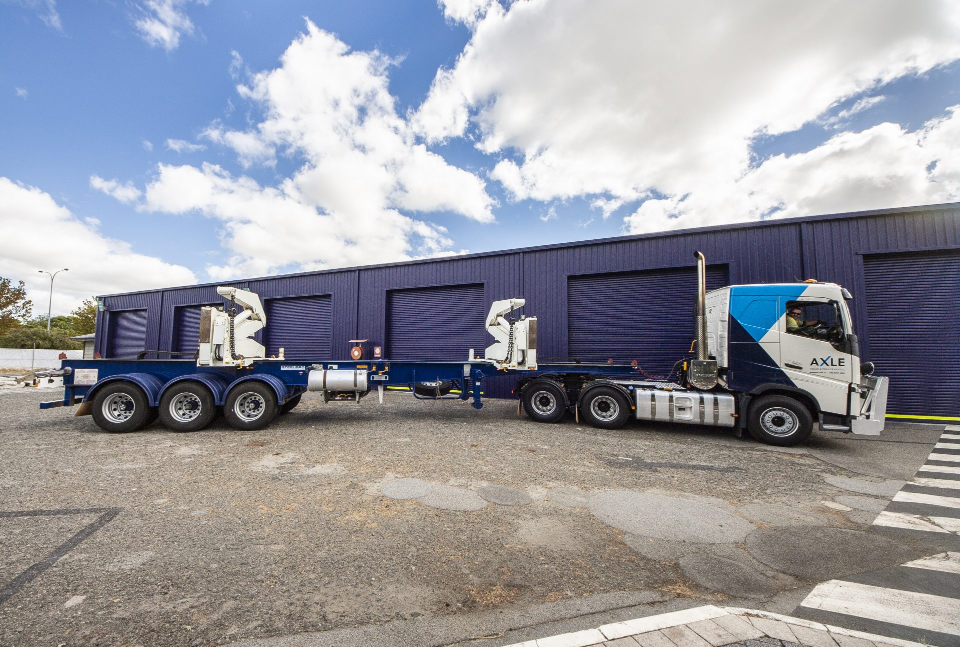 Truck with Container Side Lifters